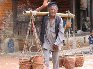 Water Carrier on High Asia Three Countries Adventure Tour {focus_keyword}  BHUTAN, TIBET & NEPAL - ASIA ADVENTURE     Water Carrier